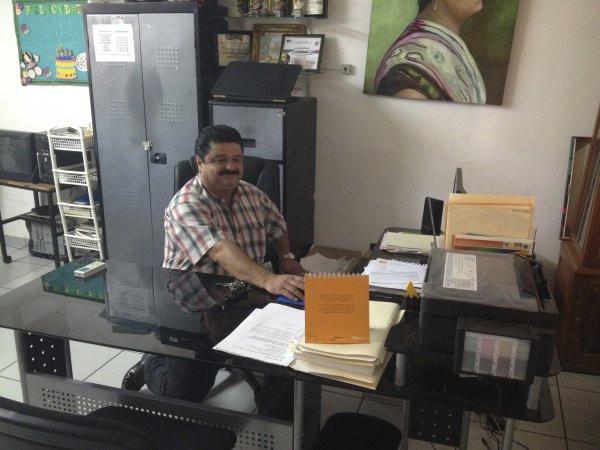 Principal Carlos Beatriz at his desk